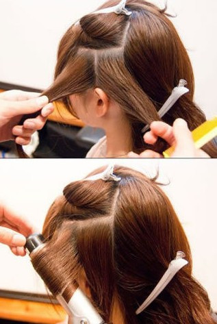 再将下区的头发分成2个区,将前面一股发卷发棒卷起来.图片