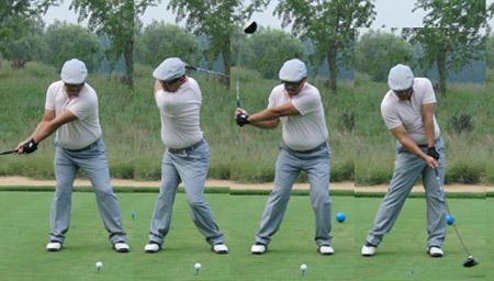 高尔夫达人花式炫技 双人配合张嘴接球