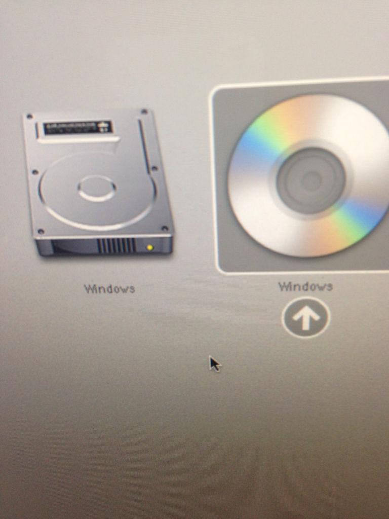 苹果电脑mac系统崩了,怎么取出光盘图片