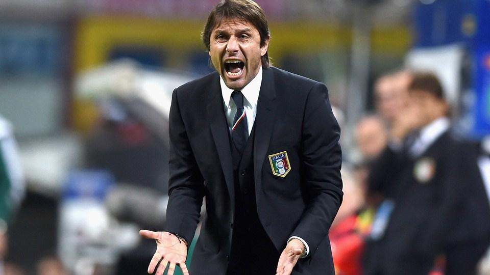 请问足球达人:这是欧洲哪个国家足球队的教练?叫什么名字?十万火急!图片