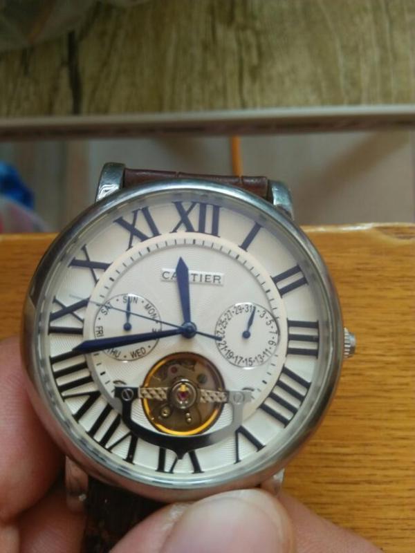 这块卡地亚男士手表,2955是真的吗图片